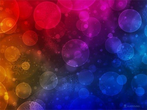 блеск разноцветных снежинок на рабочий стол