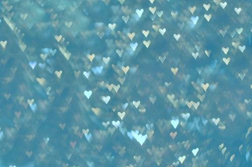 Текстура с блестящими голубыми сердцами