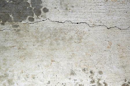 потрескавшийся серый бетон