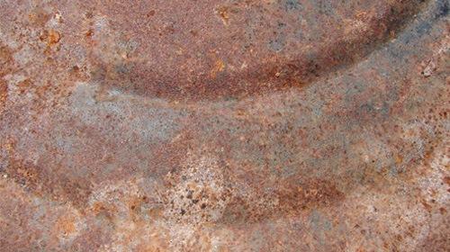 Метал с ржавыми пятнами