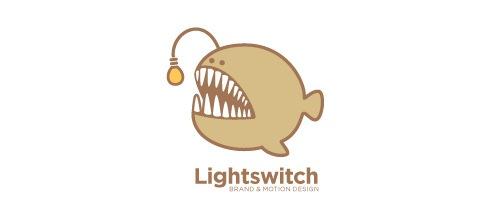 Рыбка с фонариком на лого