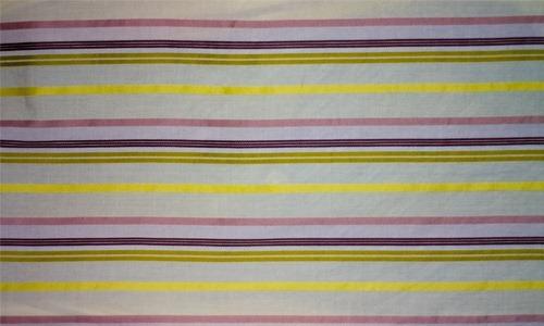 Желтые полоски на хлопчатой ткани