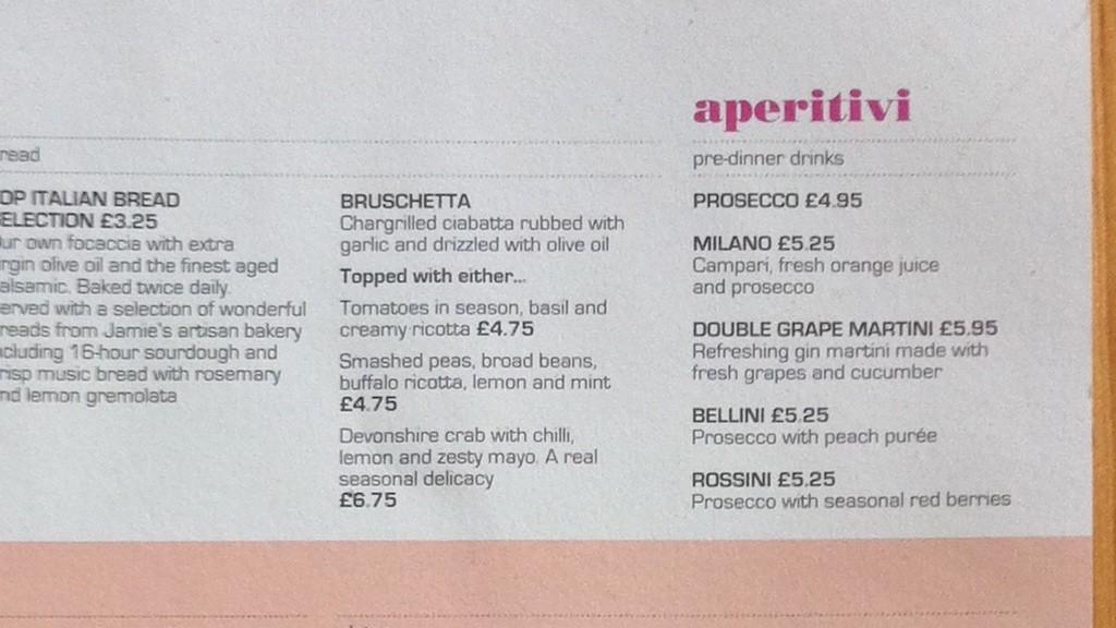 A photo of a menu using Bodini and Eurostile.